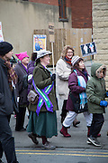 Women Dressed as Suffragette. Rally against Donald Trump, USA president elect on his first day in office, in the market town of Shipley in West Yorkshire. Protesters marched past the office of Philip Davies MP, a strong supporter of Trump and Brexit. Philip was the first MP to publicly call for Britain to withdraw from the European Union and is a member of The Freedom Association's 'Better Off Out' campaign and recently sits on the women and equalities committee in the UK government.