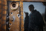 Bulletholes in the entrance door of small fashion shop looted by syrian troops. On 22. February the syrian army attacked the village of Kureen, Province of Idlib, Syria. Kureen was among the first villages in the northwest of Syria controlled by the opposition. Some villagers and members of the defence units escaped to surrounding olive orchards, when the attack begun in the early morning. A majority of the inhabitants didn´t manage to escape. The heavy shelling lasts 7 houres. Soldiers searched all houses, burnt some of them down, loote shops, stole cars and furniture. About 60 motorcycles were burnt down. Tanks demolished several houses. 6 men were executed. One woman died as a result of an heart attack.