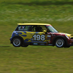 May 23, 2009; Lakeville, CT, USA; The RSR Motorsports Mini Cooper S qualifies for the Grand-Am Koni Sports Car Challenge series competition during the Memorial Day Road Racing Classic weekend at Lime Rock Park.