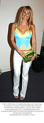 ADELA KING wife of Chester King, they own Stoke Park, at a party in London on 8th October 2003.PNK 352