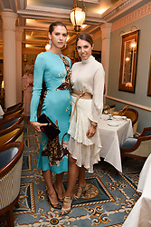 Left to right, Sabrina Percy and Amber Le Bon at an afternoon tea in honour of Megan Hess hosted by Lady Violet Manners at The Lanesborough, Hyde Park Corner, London, England. 10 November 2017.