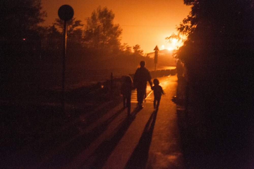 Early morning, Tuesday 15th of September 2015. The Hungarian train stopped at the station of Hegyeshalom  at 3:25 in the morning. A policeman wake up Aysha and told her to move out of the train. There was police everywhere in the station. It was foggy and the lights were dim. The refugees start waking silently through the streets of the small village. At every crossroad there was a policeman to show them the way and make sure that none will stay in Hungary. At the end of the village a policeman showed them a dark bicycle route to Austria. Aysha was walking for more that an hour in the darkness until she saw the lights in the Austrian border.