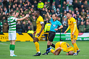 Referee Willie Collum shows Ryan Christie (#17) of Celtic FC a straight red card after his tackle on Scott Robinson (#17) of Livingston FC during the Ladbrokes Scottish Premiership match between Livingston FC and Celtic FC at The Tony Macaroni Arena, Livingston, Scotland on 6 October 2019.