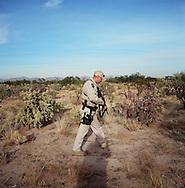 Border patrol agent John Bernal tracking footprints in the desert..Tucson, AZ.12/8/05.photos: Hector Emanuel