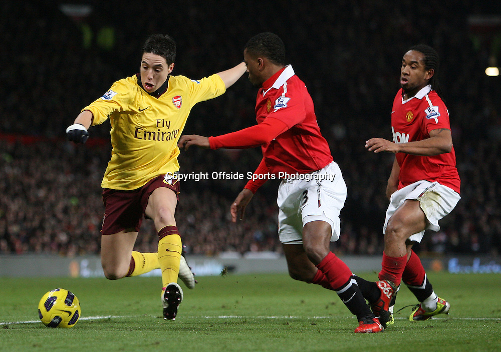 13/12/2010 - Barclays Premier League - Manchester United vs. Arsenal - Patrice Evra of Man Utd (C) and Anderson of Man Utd (R) battle with Samir Nasri of Arsenal - Photo: Simon Stacpoole / Offside.