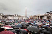 "VATICAN CITY - 13 MARCH 2013: Thousands of rain-soaked faithfuls wait for the ""fumata"" (or smoke), which is the announcement to the outer world by a conclave that a Papal has or hasn't been elected (white smoke if it has been elected; black smoke if it hasn't), in Saint Peter's square  in Vatican City, on March 13, 2013...On March 12, 2013, the 115 cardinals entered the conclave to elect a successor to Pope Benedict XVI after he became the first pope in 600 years to resign from the role. The conclave will take place inside the Sistine Chapel and will be attended by 115 cardinals as they vote to select the 266th Pope of the Catholic Church."