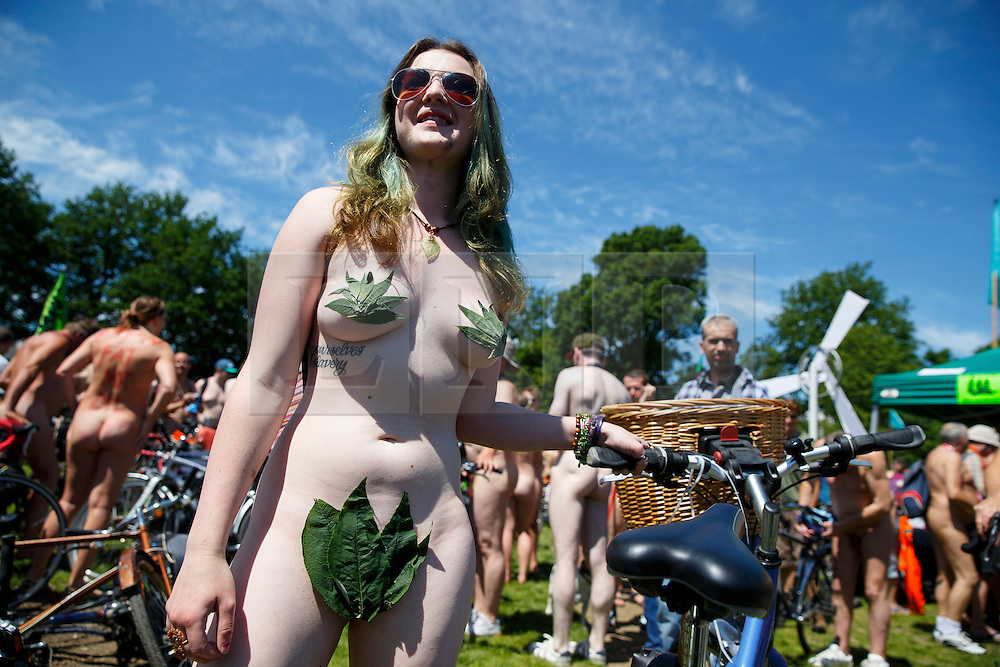 © Licensed to London News Pictures. 08/06/2014. BRIGHTON, UK. Nude protesters getting ready to cycle through the streets of Brighton on Sunday 8 June 2014 as part of the World Naked Bike Ride, which aims to raise awareness of cyclists on the roads and in the traffic. Photo credit : Tolga Akmen/LNP