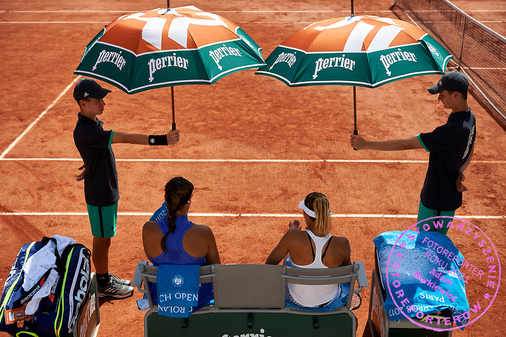 Paris, France - 2017 May 31: (L) Ana Konjuh from Croatia and (R) Magda Linette from Poland rest while their women's double match first round during tennis Grand Slam tournament The French Open 2017 (also called Roland Garros) at Stade Roland Garros on May 31, 2017 in Paris, France.<br /> <br /> Mandatory credit:<br /> Photo by &copy; Adam Nurkiewicz<br /> <br /> Adam Nurkiewicz declares that he has no rights to the image of people at the photographs of his authorship.<br /> <br /> Picture also available in RAW (NEF) or TIFF format on special request.<br /> <br /> Any editorial, commercial or promotional use requires written permission from the author of image.