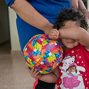 NOVEMBER 17, 2017&ndash;MARICAO, PUERTO RICO&mdash;<br /> Stephanie Colon Medina, 27, with her two year old daughter Kayla Ferrer Colon. Colon Medina received a cash amount and water filtration system from Mercy Corps.<br /> (Photo by Angel Valentin)