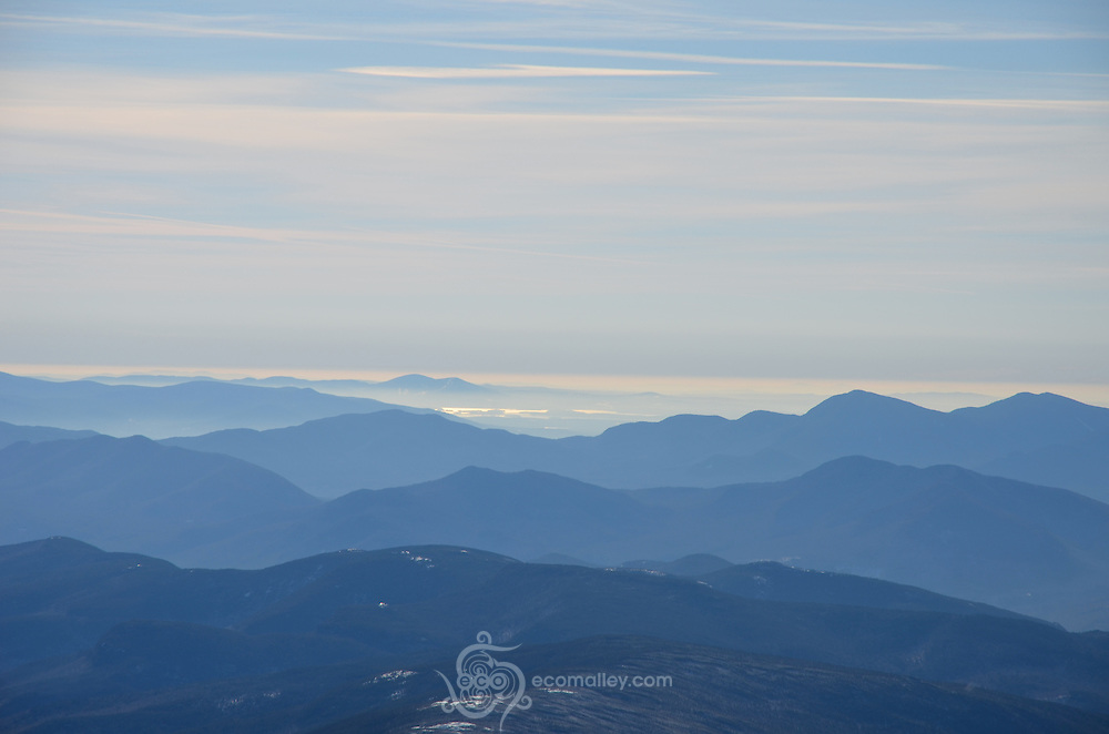 Clouds and distant peaks as seen from Mount Washington.