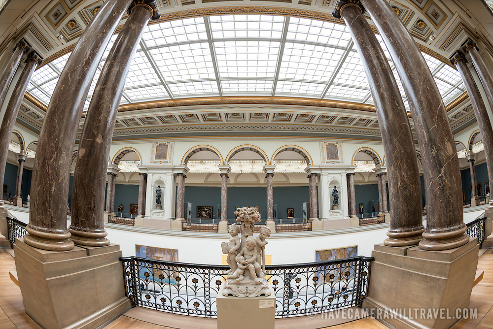 A side view of the main hall at the Royal Museums of Fine Arts in Belgium (in French, Musées royaux des Beaux-Arts de Belgique), one of the most famous museums in Belgium. The complex consists of several museums, including Ancient Art Museum (XV - XVII century), the Modern Art Museum (XIX  XX century), the Wiertz Museum, the Meunier Museum and the Museé Magritte Museum.