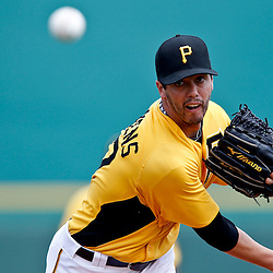 March 22, 2012; Bradenton, FL, USA; Pittsburgh Pirates starting pitcher Jeff Karstens (27) throws during the top of the first inning of a spring training game against the Tampa Bay Rays at McKechnie Field. Mandatory Credit: Derick E. Hingle-US PRESSWIRE