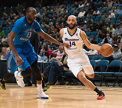 March 20, 2017 - Reno, Nevada, U.S - Reno Bighorn Guard KENDALL MARSHALL (14) drives against Texas Legends Forward STÆ'PHANE LASME (13) during the NBA D-League Basketball game between the Reno Bighorns and the Texas Legends at the Reno Events Center in Reno, Nevada. (Credit Image: © Jeff Mulvihill via ZUMA Wire)