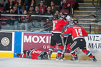 KELOWNA, CANADA - NOVEMBER 21: Colten Martin #8 of Kelowna Rockets checks a player of the Portland Winterhawks into the boards after a hit on Jesse Lees #2 of Kelowna Rockets on November 21, 2014 at Prospera Place in Kelowna, British Columbia, Canada.  (Photo by Marissa Baecker/Shoot the Breeze)  *** Local Caption *** Jesse Lees; Tomas Soustal; Colten Martin;