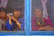 BHUTAN, PEOPLE women behind blue  screen windows