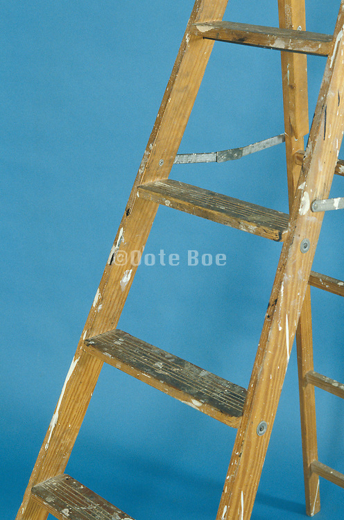 wooden ladder with paint splatters