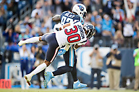 NASHVILLE, TN - DECEMBER 3:  Delanie Walker #82 of the Tennessee Titans catches a pass and runs the ball for a touchdown while being tackled by Kevin Johnson #30 of the Houston Texans at Nissan Stadium on December 3, 2017 in Nashville, Tennessee.  The Titans defeated the Texans 23-14.  (Photo by Wesley Hitt/Getty Images) *** Local Caption *** Delanie Walker; Kevin Johnson