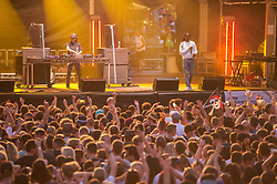 © Licensed to London News Pictures.  21/07/2018; Bristol, UK. Bristol Harbour Festival. RONI SIZE onstage headlining the festival on Saturday night. Bristol Harbour Festival is a 3 day extravaganza of dance, music, theatre, circus, ships and boats, arts and delicious food. The festival is free for all and brings over 250,000 people together each summer to celebrate Bristol's rich maritime history and enjoy some of the city's best music and entertainment. The festival takes place on the  20 - 22 July 2018. Photo credit: Simon Chapman/LNP