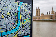 A tourism map showing the River Thames in the centre running between Southwark and Lambeth on the left and Westminster on the right bank, with the Houses of Parliament across the water, on 27th March 2019, in London, England
