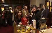 Jade Jagger and Charlotte Monckton. Charity sale of the last ever sale at Asprey and Garrard. New Bond St. London. 15/1/02© Copyright Photograph by Dafydd Jones 66 Stockwell Park Rd. London SW9 0DA Tel 020 7733 0108 www.dafjones.com