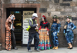 Spectacular costumes from a classic children's book, a sci-fi ballet and the Mexican underworld are showcased by University of Edinburgh students. <br /> <br /> The outfits have been designed by Performance Costume students for a jaw-dropping theatrical show. The Performance Costume Show takes place in Edinburgh College of Art's Sculpture Court on 18 and 19 May.<br /> <br /> Children's book favourite The Tiger Who Came to Tea is brought to life by student Gracie Martin's art deco design. She has imagined the tiger as a 1920s gangster wearing a pinstripe suit and tie.<br /> <br /> Yan Smiley has created characters for a sci-fi ballet set in 17th century Scotland. The outfit is inspired by stained glass windows and rugged Highland landscapes.<br /> <br /> Ellie Finch has made a dazzling outfit for Maid Marian, set in contemporary Mexico. The vibrant outfit highlights iconography linked to the country's drug cartels, with a headdress of poppies and needles and a kaleidoscopic skirt covered in prints of machine guns and cannabis leaves. <br /> <br /> Irvine Welsh's novel Marabou Stork Nightmares was the focus of Dayna Ali's surreal designs. She has created the Marabou Stork – half bird, half football hooligan. He has a large head and beak and wears fluorescent '90s sportswear with a specially made Marabou logo.<br /> <br /> Zoe Frewin has created costumes from Disney Pixar's animation, A Bug's Life. Inspired by George Orwell's 1984, the insects wear uniforms and their colour denotes their class in society.<br /> <br /> Pictured: Josef Stitts wearing costume from The Tiger That Came for Tea designed by Gracie Martin, Gracie Martin wearing Maid Marion costume designed by Ellie Finch and Rachael Weir and Maddie Williams wearing Bugs Life costumes designed by Zoe Frewin