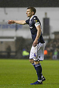 Millwall defender Shaun Hutchinson (4) gestures during the The FA Cup fourth round match between Millwall and Everton at The Den, London, England on 26 January 2019.