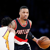 26 March 2016: Portland Trail Blazers guard Damian Lillard (0) brings the ball up court against Los Angeles Lakers guard D'Angelo Russell (1) during the Portland Trail Blazers 97-81 victory over the Los Angeles Lakers, at the Staples Center, Los Angeles, California, USA.