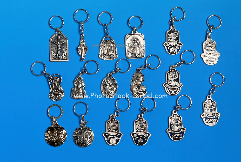 Israeli and Holyland amulets and souvenirs on blue background
