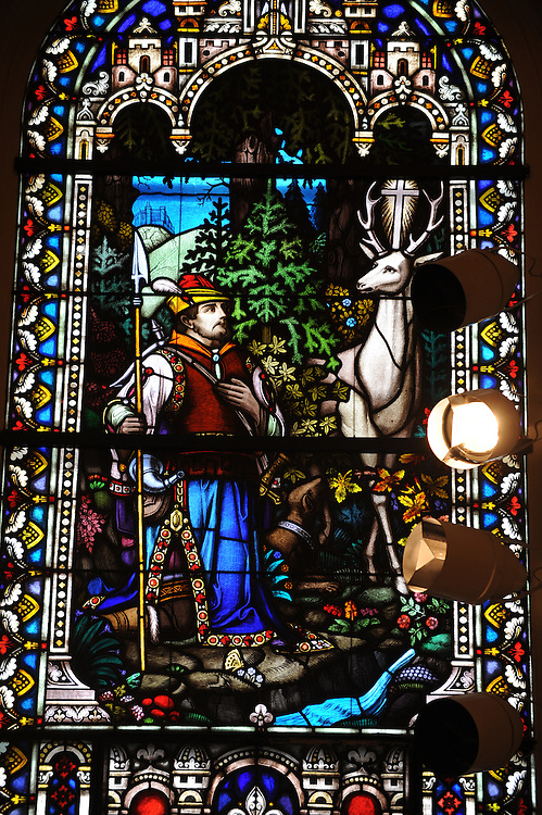 St. Hubertus, patron saint of hunters, is pictured in a stained glass window at Ss. Peter and Paul Church in Green Bay. (Sam Lucero photo)