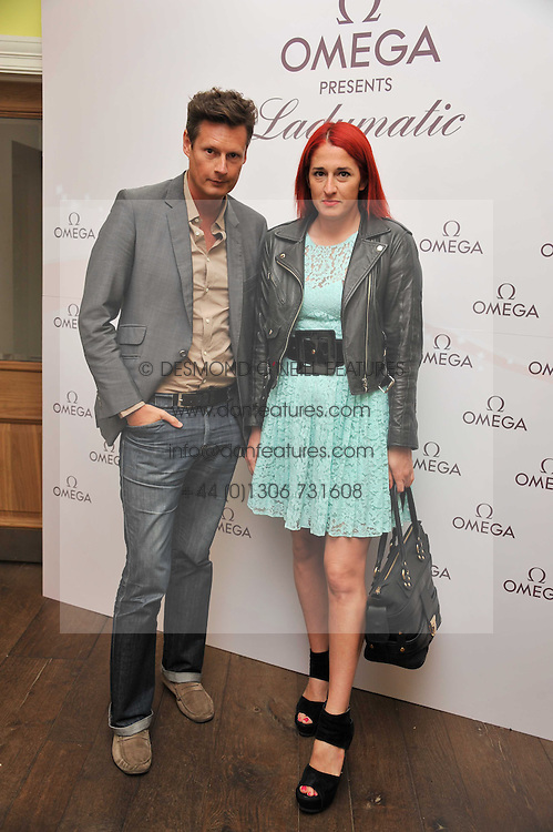 PERCY PARKER and AMY MOLYNEAUX at a pool party to celebrate the UK launch of the Omega Ladymatic Collection held at the Haymarket Hotel, Haymarket, London on 16th June 2011.