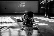 Xinh, 12, lives in a solitary world. She was born without eyes, and spends the majority of her days in this position.