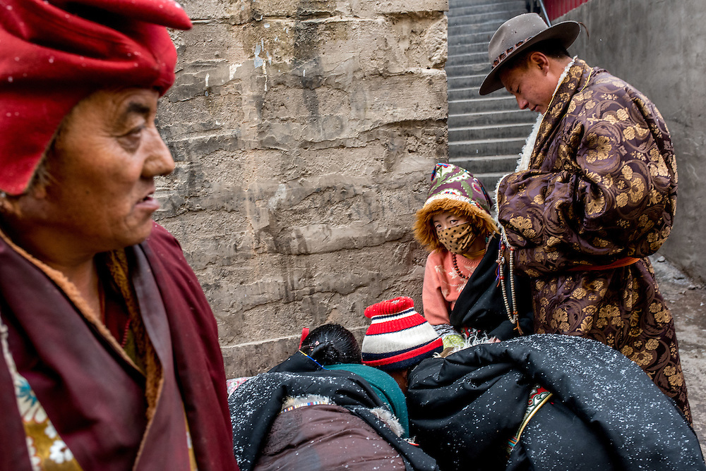 Shoppers browse through the market in the town of Zado, Tibet (Qinghai, China).