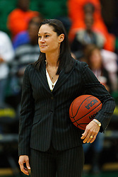 Dec 7, 2011; San Francisco CA, USA;  San Francisco Lady Dons head coach Jennifer Azzi watches her team warm up before the game against the Florida Gators at War Memorial Gym.  Florida defeated San Francisco 91-68. Mandatory Credit: Jason O. Watson-US PRESSWIRE