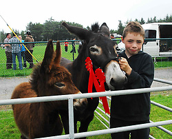 Kenneth McGing, from Glenmask had the champion mare donkey and foal  at the Tourmakeady Show ...Pic Conor McKeown