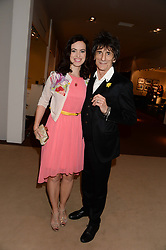 RONNIE WOOD and his wife SALLY HUMPHREYS at the Masterpiece Midsummer Party in aid of Marie Curie Cancer Care held at The Royal Hospital Chelsea, London on 2nd July 2013.