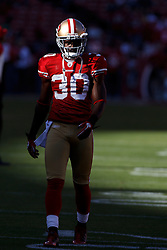 October 10, 2010; San Francisco, CA, USA;  San Francisco 49ers safety Reggie Smith (30) warms up before the game against the Philadelphia Eagles at Candlestick Park. The Eagles defeated the 49ers 27-24.