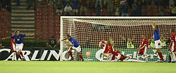 BELGRADE, SERBIA & MONTENEGRO - Wednesday, August 20, 2003: Wales' players look dejected as Serbia & Montenegro's Dragan Mladenovic celebrates scoring the only goal of the game during the UEFA European Championship qualifying match at the Red Star Stadium. (Pic by David Rawcliffe/Propaganda)