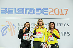 Second placed Alina Talay of Belarus, winner Cindy Roleder of Germany and third placed Pamela Dutkiewicz of Germany celebrate during victory ceremony after competing in the 60 m Hurdles Women Final on day two of the 2017 European Athletics Indoor Championships at the Kombank Arena on March 4, 2017 in Belgrade, Serbia. Photo by Vid Ponikvar / Sportida