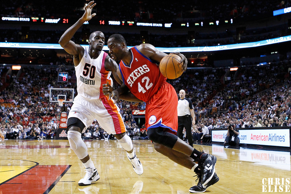 21 January 2012: Philadelphia Sixers power forward Elton Brand (42) drives past Miami Heat center Joel Anthony (50) during the Miami Heat 113-92 victory over the Philadelphia Sixers at the AmericanAirlines Arena, Miami, Florida, USA.