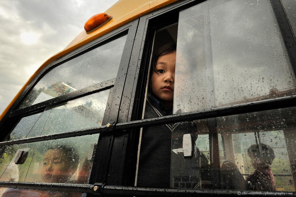 A tibetan girl in a school bus iat a tibetan school in Manali, India, 2009