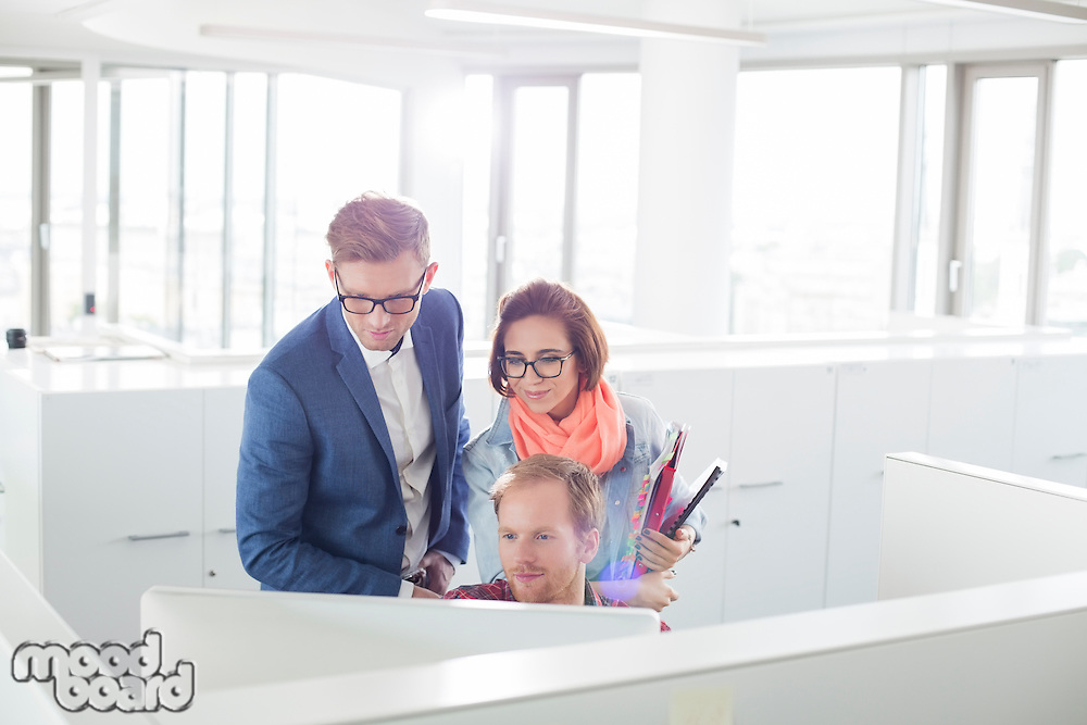 Business people working on computer in creative office