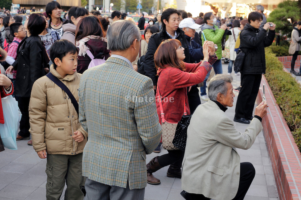 people making pictures in front of Tokyo station Japan