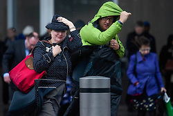 © Licensed to London News Pictures. 06/06/2017. London, UK.  Commuters fight against gales and heavy rain while leaving London Bridge Station as the capital is hit by wintery conditions. Photo credit: Ben Cawthra/LNP