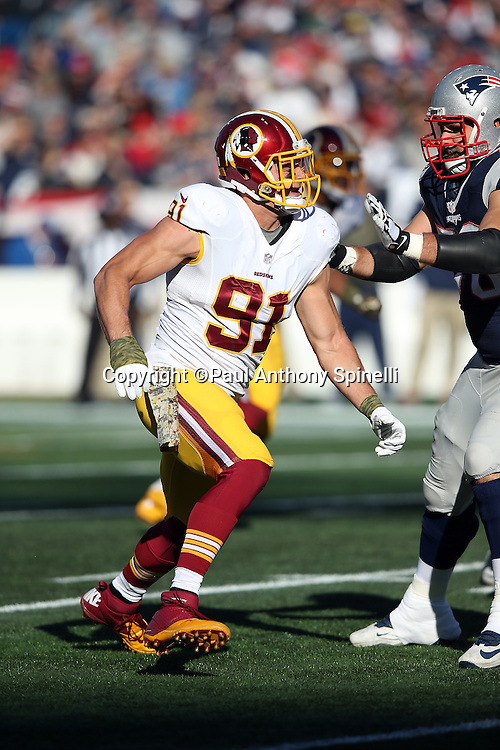 Washington Redskins outside linebacker Ryan Kerrigan (91) works his way around a block by New England Patriots tackle Sebastian Vollmer (76) as he rushes the quarterback during the 2015 week 9 regular season NFL football game against the New England Patriots on Sunday, Nov. 8, 2015 in Foxborough, Mass. The Patriots won the game 27-10. (©Paul Anthony Spinelli)