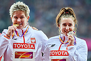 Great Britain, London - 2017 August 07: (L) Anita Wlodarczyk (Skra Warszawa) and (R) Malwina Kopron (AZS Poznan) both of Poland bite their medals while awarding ceremony in women&rsquo;s hammer throw during IAAF World Championships London 2017 Day 4 at London Stadium on August 07, 2017 in London, Great Britain.<br /> <br /> Mandatory credit:<br /> Photo by &copy; Adam Nurkiewicz<br /> <br /> Adam Nurkiewicz declares that he has no rights to the image of people at the photographs of his authorship.<br /> <br /> Picture also available in RAW (NEF) or TIFF format on special request.<br /> <br /> Any editorial, commercial or promotional use requires written permission from the author of image.