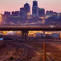 Kansas City Missouri skyline at dawn, view from Mill Street bridge above rail yards in Kansas City, Kansas.