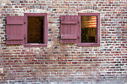 Windows on a civil war era slave cabin at Boone Hall Plantation in Mt Pleasant, South Carolina.