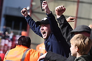 A Doncaster fan celebrates Mallik Wilks' goal during the EFL Sky Bet League 1 match between Bradford City and Doncaster Rovers at the Northern Commercials Stadium, Bradford, England on 6 April 2019.