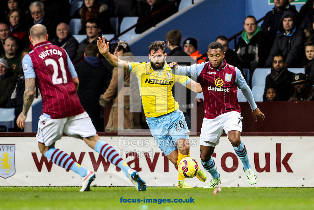 Joe Ledley of Crystal Palace (centre) competing with Leandro Bacuna of Aston Villa (right) during the Barclays Premier League match at Villa Park, Birmingham<br /> Picture by Andy Kearns/Focus Images Ltd 0781 864 4264<br /> 01/01/2015