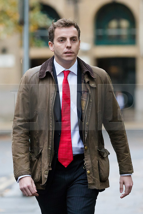 © Licensed to London News Pictures. 15/10/2018. London, UK.  NATHAN GRAY arrives at Southwark Crown Court in London for a trial in connection with charges of illegal election spending during the 2015 general election. South Thanet MP Craig Mackinlay, 51, campaign director Marion Little, 63, and election agent Nathan Gray, 29, have each been charged with offences under the Representation of the People Act 1983.  Photo credit: Vickie Flores/LNP